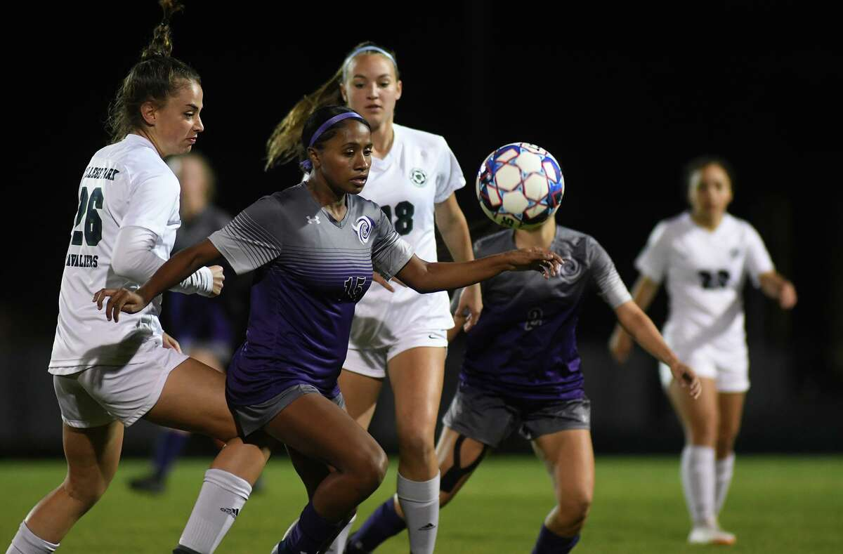 Klein Cain senior Peewee Remi, center, was named 2020-21 District 15-6A Offensive Player of the Year following the conclusion of the season which ended with a loss by the Lady Hurricanes in the UIL girls soccer tournament.