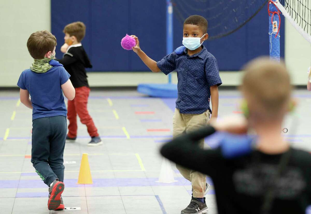 Kindergartner Dubem Akunyili, 5, during P.E. class at Creekside Forest Elementary in Tomball ISD, in Spring, Wednesday, Feb. 3, 2021. Creekside Forest Elementary earned the number two spot for best elementary school in the Houston region in Children at Risk's annual rankings. Tomball ISD was rated as the best school district in the region and fifth best in the state.
