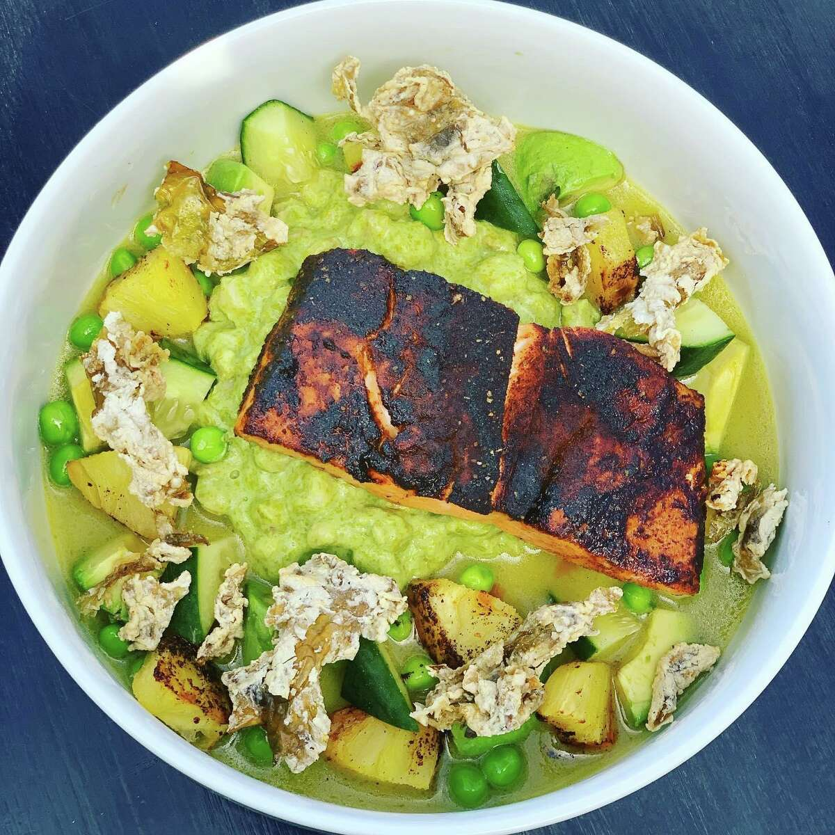 At The Essex in Centerbrook, chef Colt Taylor will offer an al pastor-style roasted Ora King salmon, served with heirloom corn hominy
