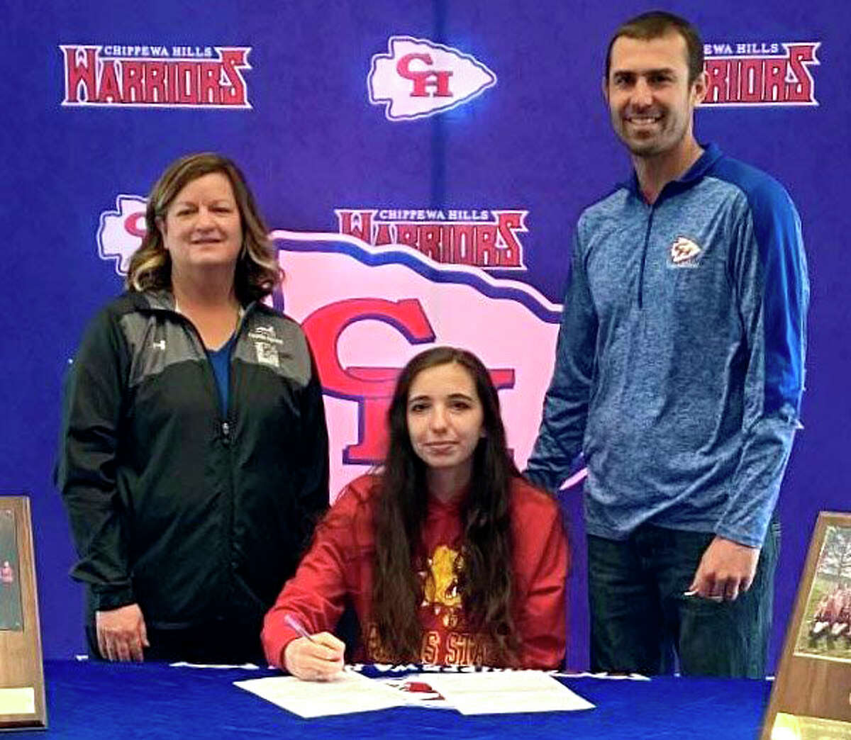 Chippewa Hills senior Emily Fredrick recently signed a letter of intent to join Ferris State's track and field program. She is pictured at her signing with Chippewa Hills assistant coach Sally Schafer (left) and head coach Zach Hatfield.