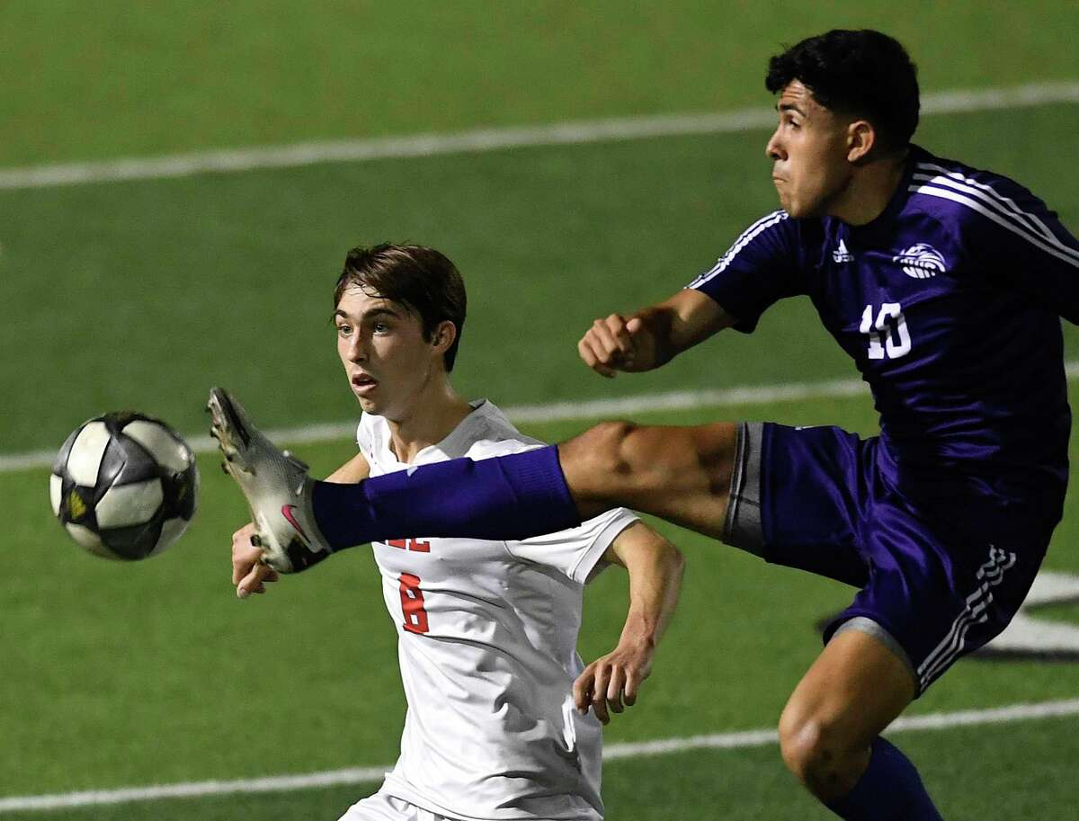 Felipe Martinez (10) of Jersey Village kicks the ball as Gavin Seesholtz of LEE defends during the Class 6A state semifinal in Georgetown on Tuesday, April 13, 2021.