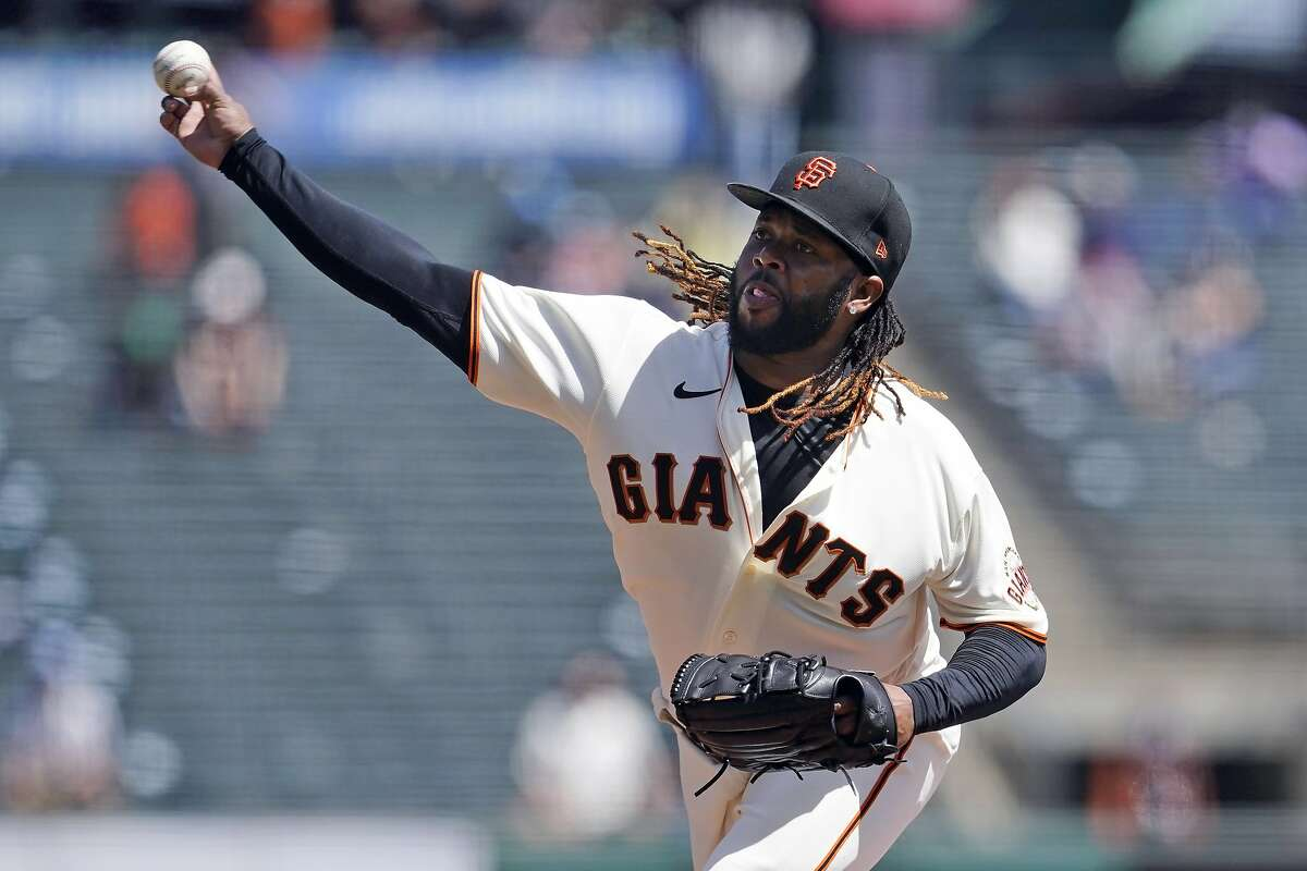 San Francisco Giants pitcher Johnny Cueto throws during the first inning of a baseball game against the Cincinnati Reds in San Francisco, Wednesday, April 14, 2021. (AP Photo/Jeff Chiu)