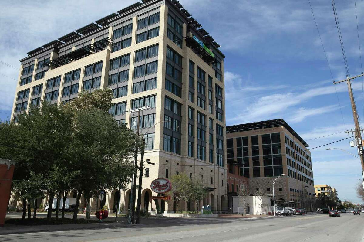 Noted San Antonio restaurateur Peter Selig is set to open an Italian restaurant named Allora in the Credit Human tower, left, and a fast-casual concept called Arrosta in the neighboring Oxbow building, right, later this year.