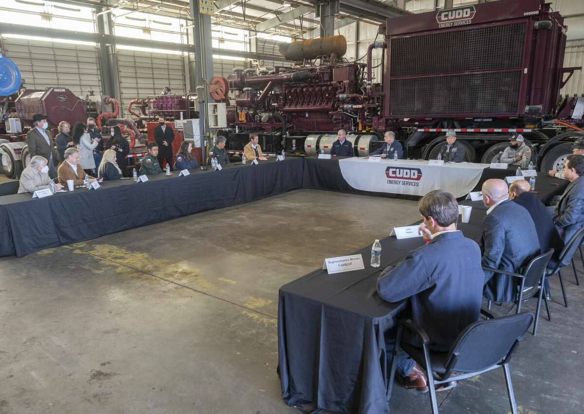 Texas Governor Greg Abbott leads a roundtable discussion with Travis Stice, left, with Diamondback Energy and Clint Walker, right, with Cudd Energy, January 28 at Cudd Energy Services in Odessa, with oil and gas leaders and workers, as well as state legislators.