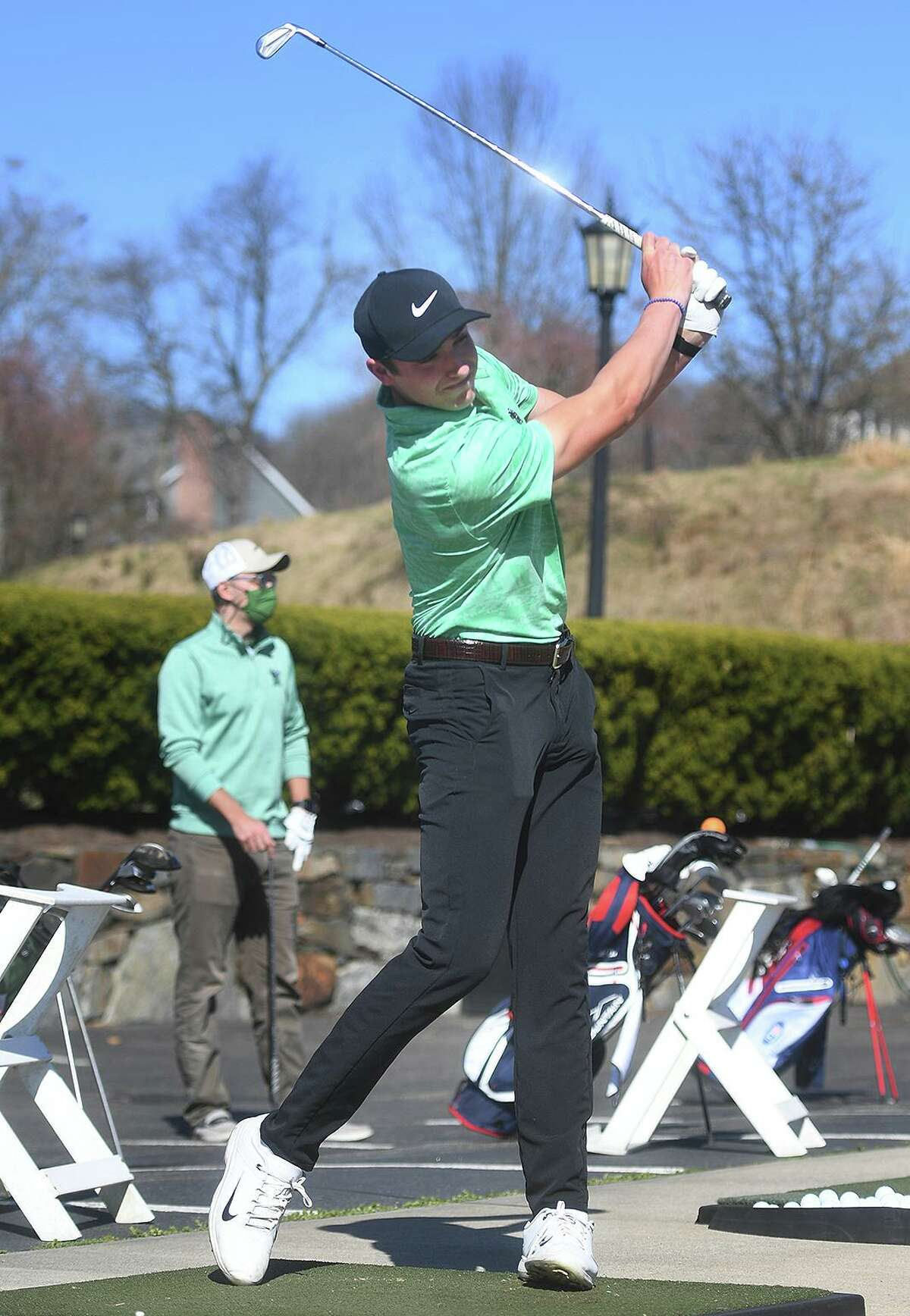 Hamden Hall junior Ben James hits the range during team practice at Great River Country Club in Milford on April 7.