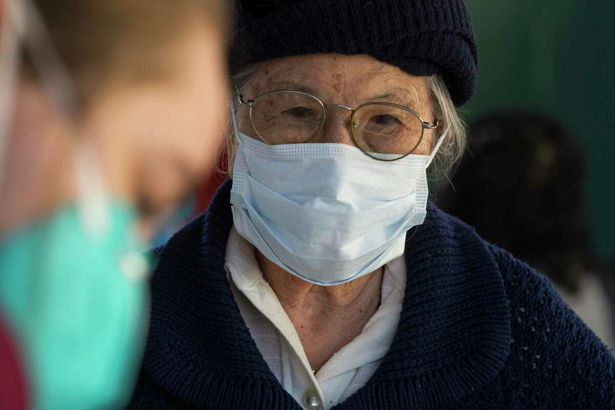 Nhuong Le, 81, waits to receive the Johnson & Johnson COVID-19 vaccine at Thái Xuân Village condominiums Sunday, April 11, 2021 in Houston. The Vietnamese Culture and Science Association teamed with Kroger, the Vietnamese American Medical Association and the Vietnamese American Nurses Association to bring 315 doses of the Johnson & Johnson COVID-19 vaccines to the residents at the condominiums located in Southeast Houston near Hobby Airport with predominantly Vietnamese residents.
