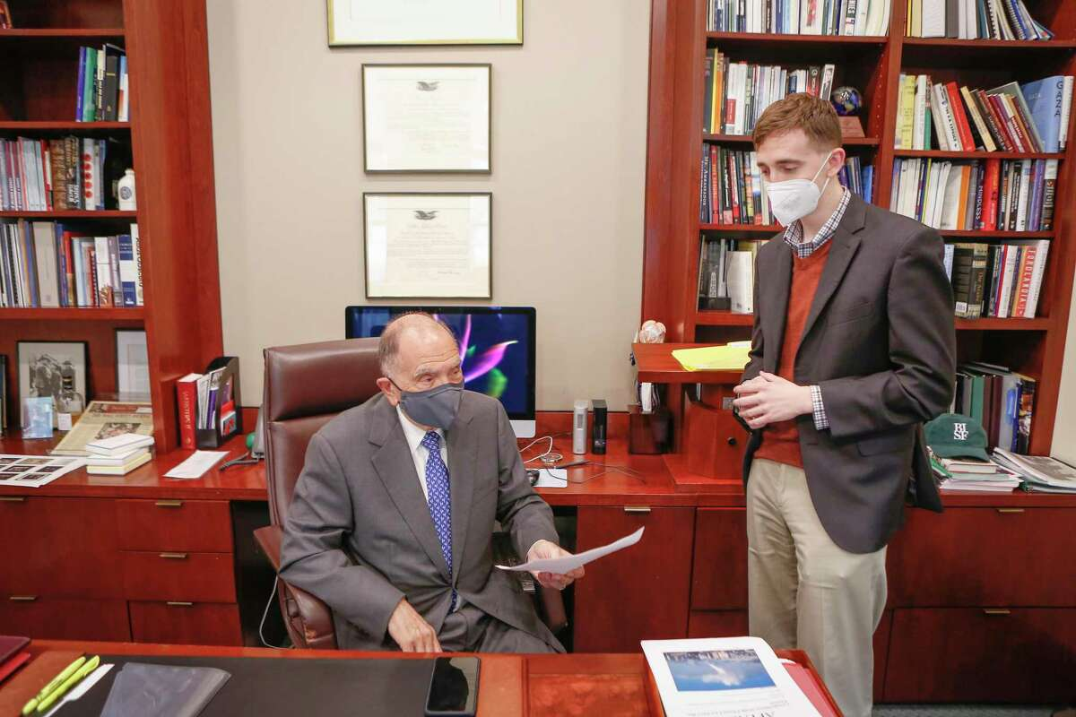 Ambassador Edward Djerejian meets with Colton Cox, policy assistant to the ambassador, in his Rice University's Baker Institute office Tuesday, April 13, 2021, in Houston.