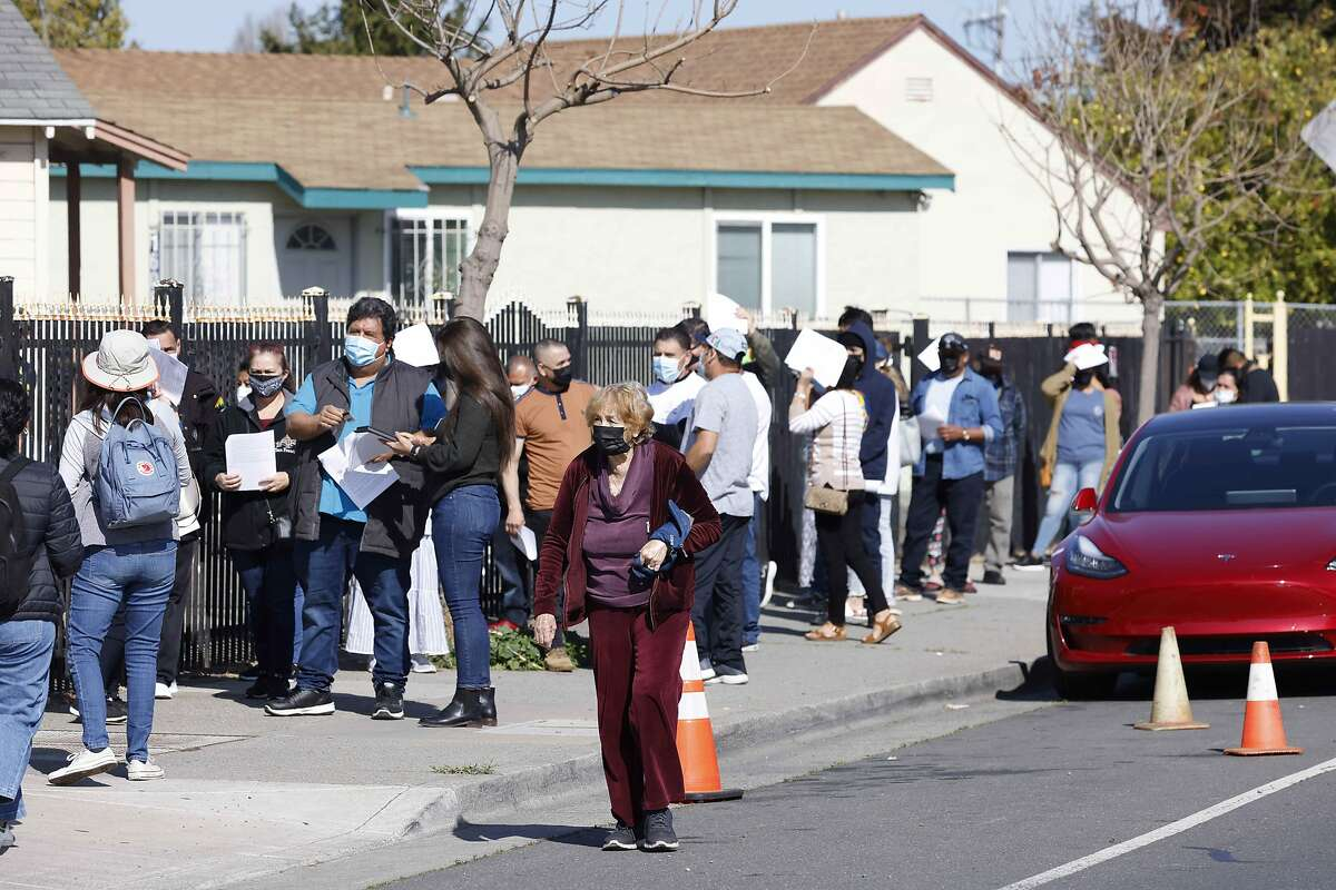 A line at the Iglesia Fuente De Salvacion Church as the Community Clinic Consortium in Contra Costa and Solano Counties host a free vaccination clinic on Saturday, April 10, 2021 in San Pablo, Calif.