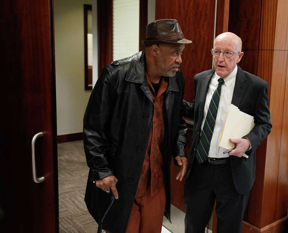 Steven Mallet, left, leaves with attorney, Robert Wicoff, from court Thursday, Feb. 13, 2020 in Houston after being declared 'actually innocent' of drug charges for which he was convicted. His conviction was based on the casework of Gerald Goines, ex narcotic officer connected to fatal Harding St. raid.