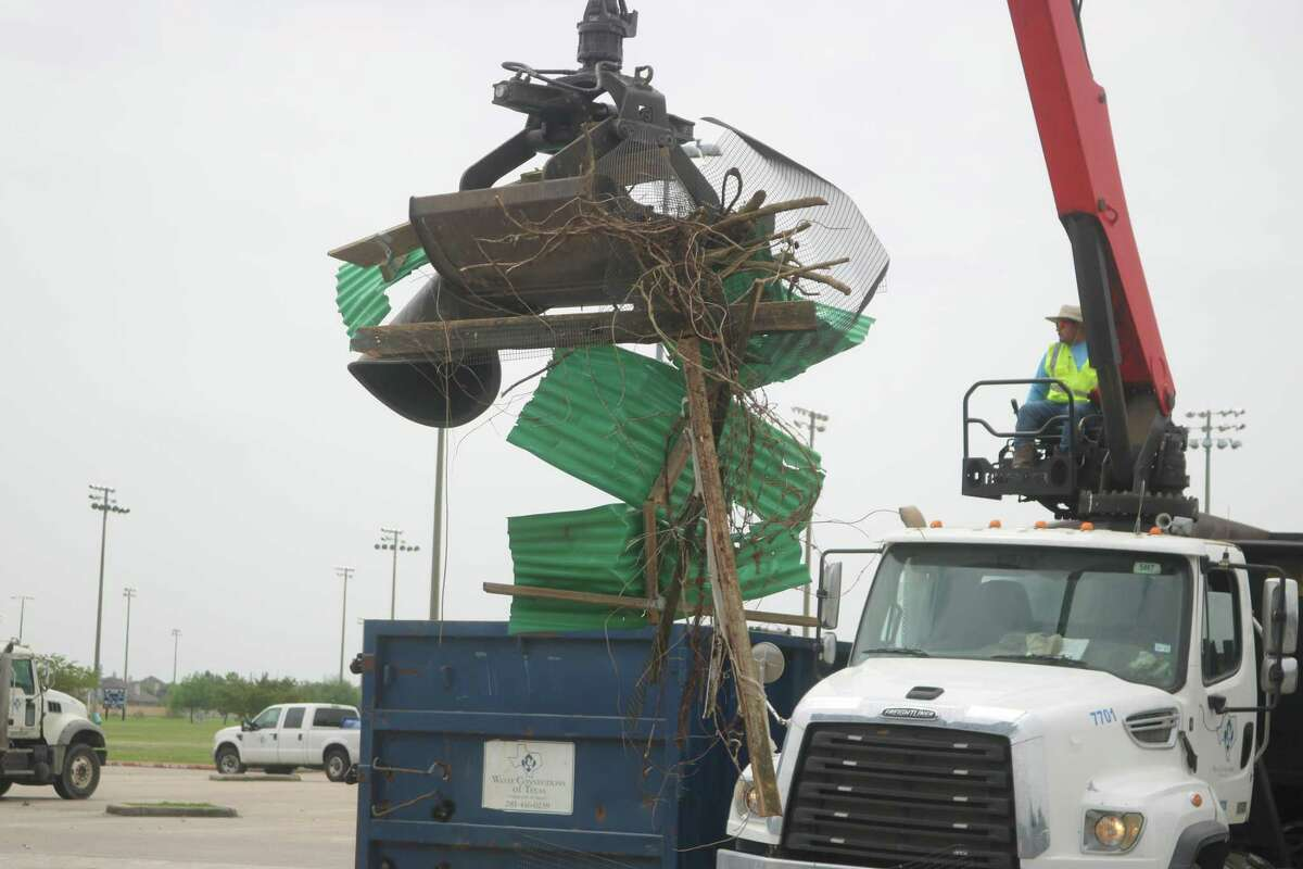 More refuse heads for a bin during Friendswood's Spring Sparkle.