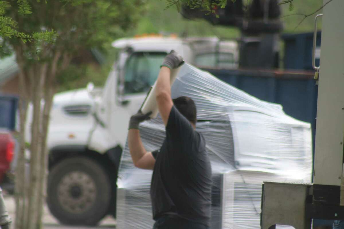 Electronic equipment is wrapped and prepared to be hauled away during the city's Spring Sparkle last weekend.