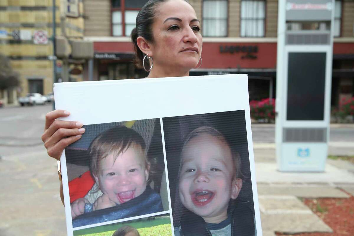 Mariesol Gomez holds a poster with images of her grand nephew, James Avi Chairez, while standing outside the Bexar County Courthouse, Wednesday, April 14, 2021. Her niece and child's mother, D'Lanny Chairez was in an arraignment hearing on child abandonment charges. Chairez and her 18-month-old son went missing on January 4. She was later arrested in March but the child has not been found.