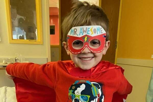 Jace Bruno, 5, of Milford, literally ran out of Yale-New Haven Hospital wearing a superhero cape.