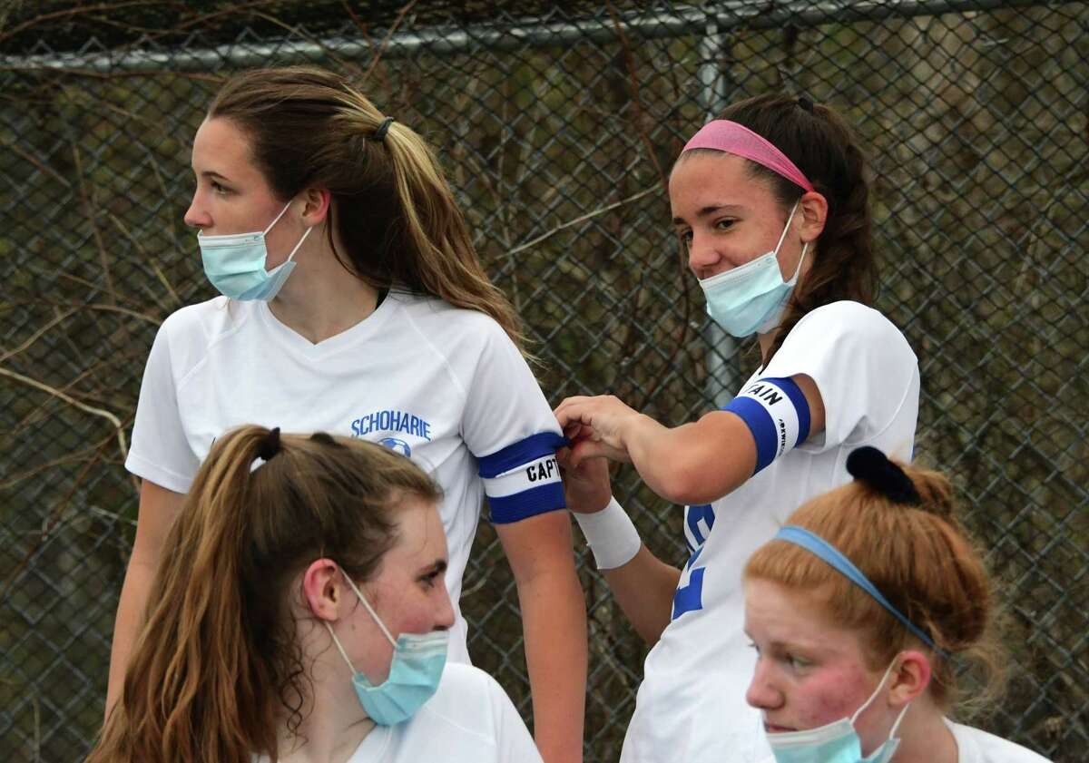 Schoharie's Megan, left, and Katie Krohn are seen together during a water and mask break at a soccer game against Duanesburg on Wednesday, April 14, 2021 in Delanson, N.Y. (Lori Van Buren/Times Union)