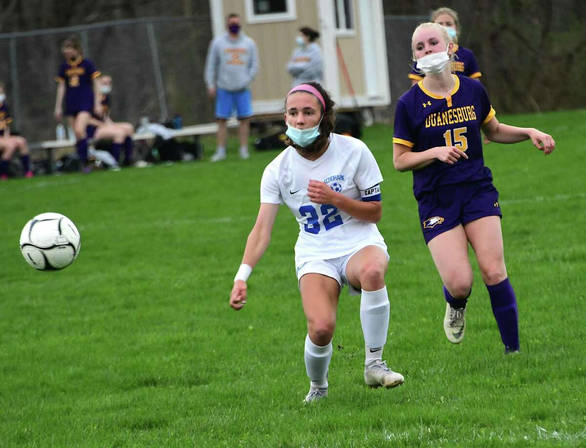 Schoharie's Katie Krohn kicks the ball while defended by Duanesburg's Julianna Perillo during a soccer game on Wednesday, April 14, 2021 in Delanson, N.Y. (Lori Van Buren/Times Union)