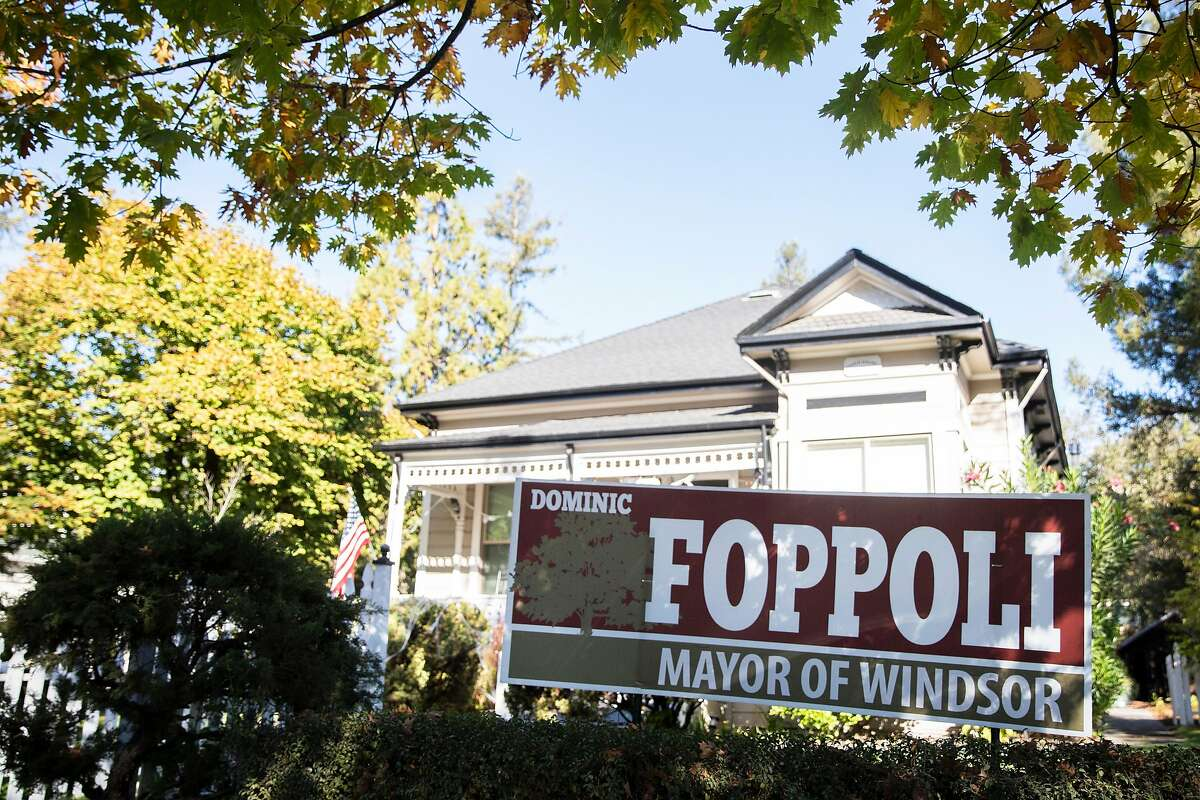 Signs endorsing Dominic Foppoli for Mayor of Windsor are seen posted outside of a home near downtown Windsor, Calif. Saturday, October 31, 2020. Windsor Mayor Dominic Foppoli has been accused by multiple women of sexual assault dating as far back as 2003.