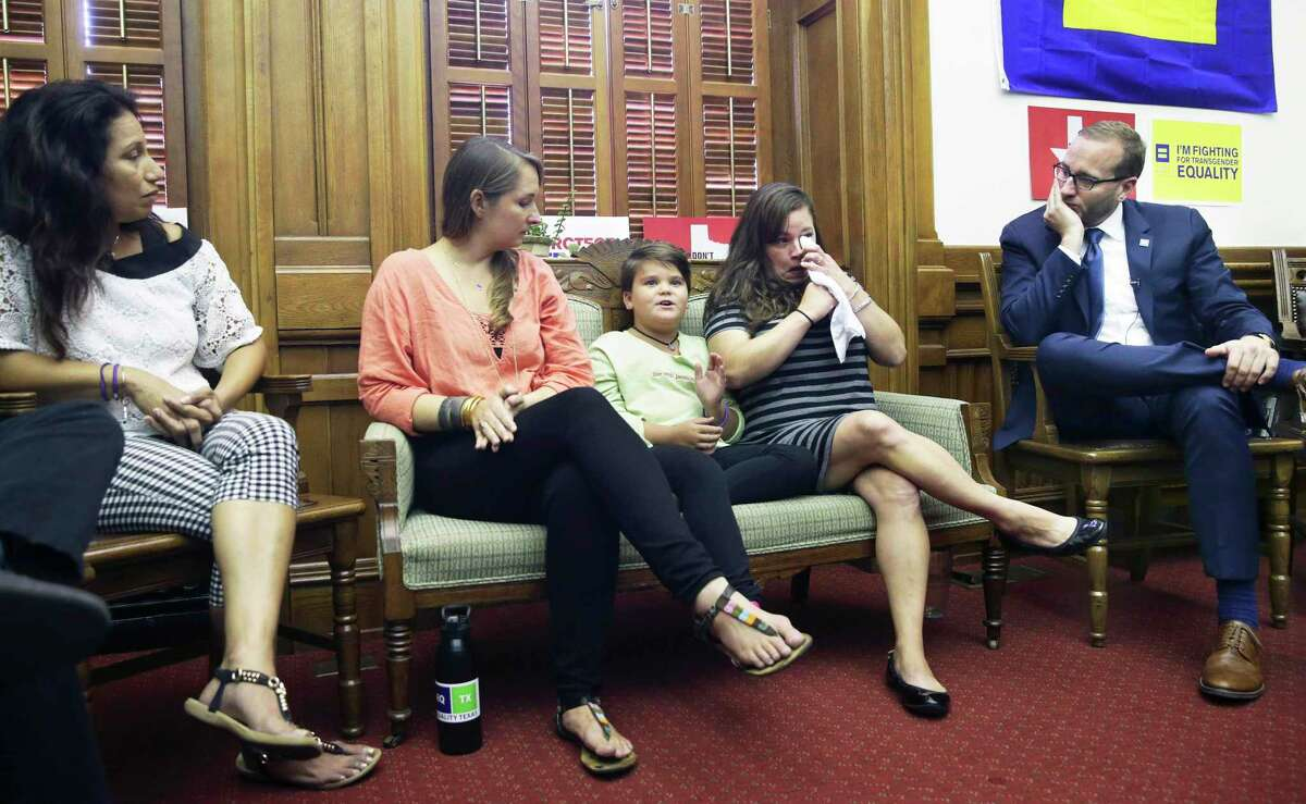 Human Rights Campaign President Chad Griffin listens as Marilyn Morrison, a child struggling with transgender issues, describes life at school during a round table discussion in the offices of State Representative Jessica Ferrar's office at the State Capitol on August 3, 2017. Chelsa Morrison, Marilyn's mother, fights back tears during the account. Next to Marilyn, Rachel Gonzales listens with Angie Castro (far left).