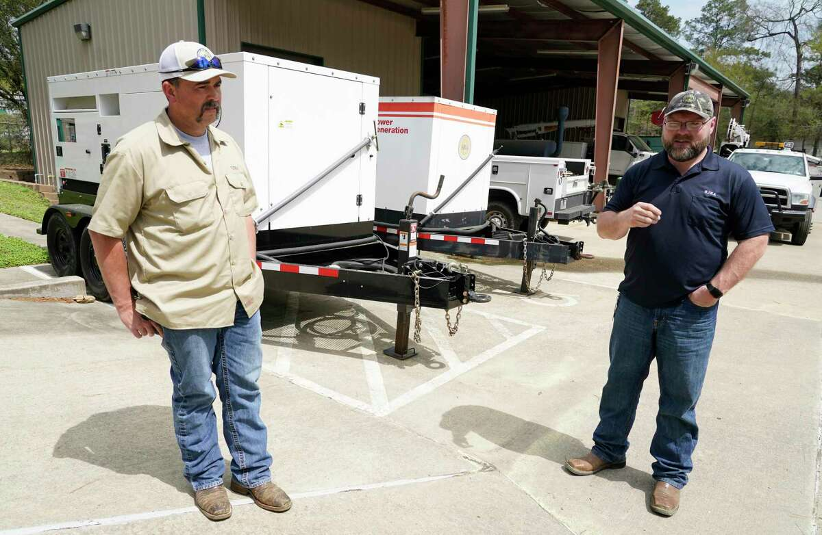Jacob Everett, chief maintenance technician, left, and Jason Williams, operation manager, right, talk near the portable generators at the San Jacinto River Authority Wastewater Treatment Plant No. 1 Wednesday, March 17, 2021 in The Woodlands.