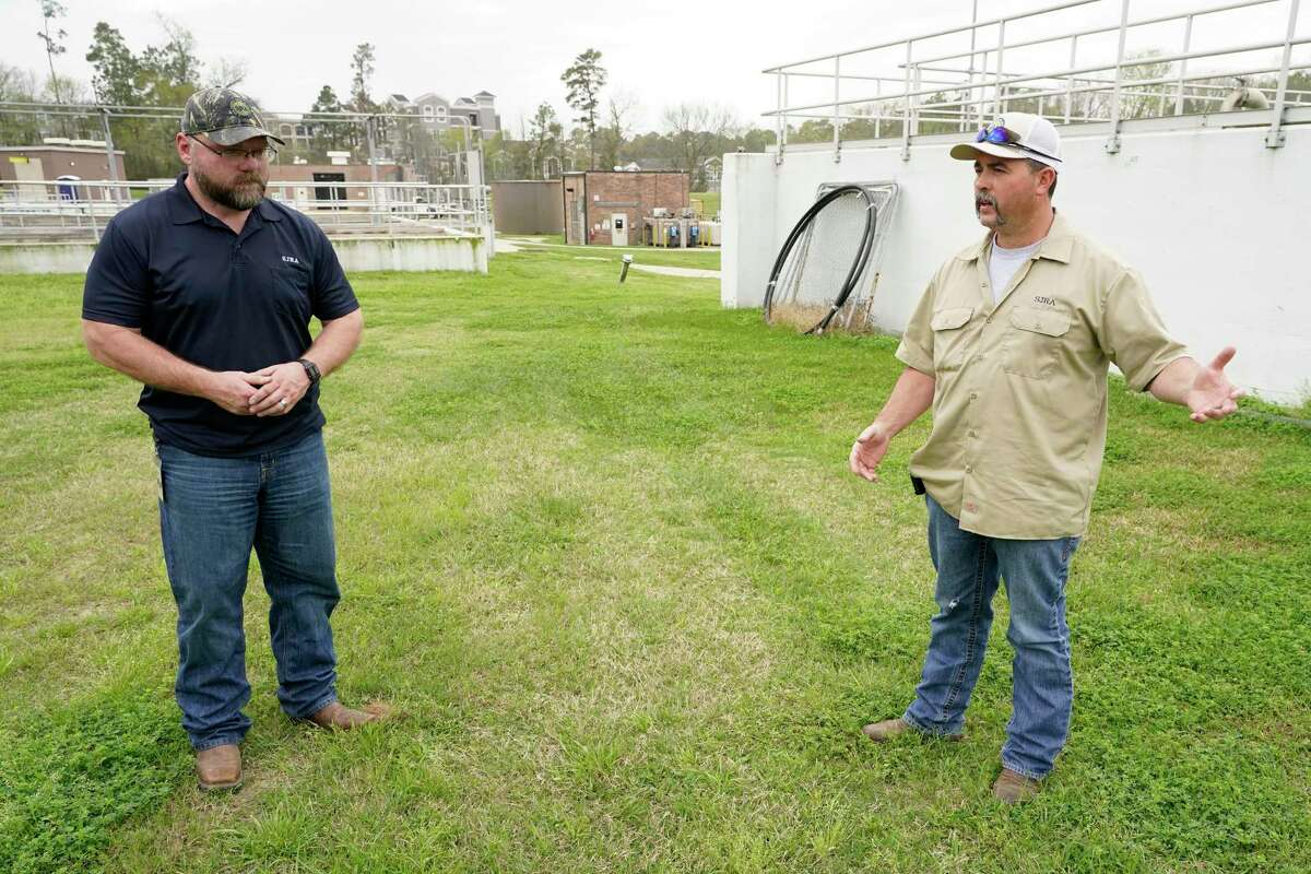 Jason Williams, operation manager, left, and Jacob Everett, chief maintenance technician, right, talk at the San Jacinto River Authority Wastewater Treatment Plant No. 1 Wednesday, March 17, 2021 in The Woodlands.