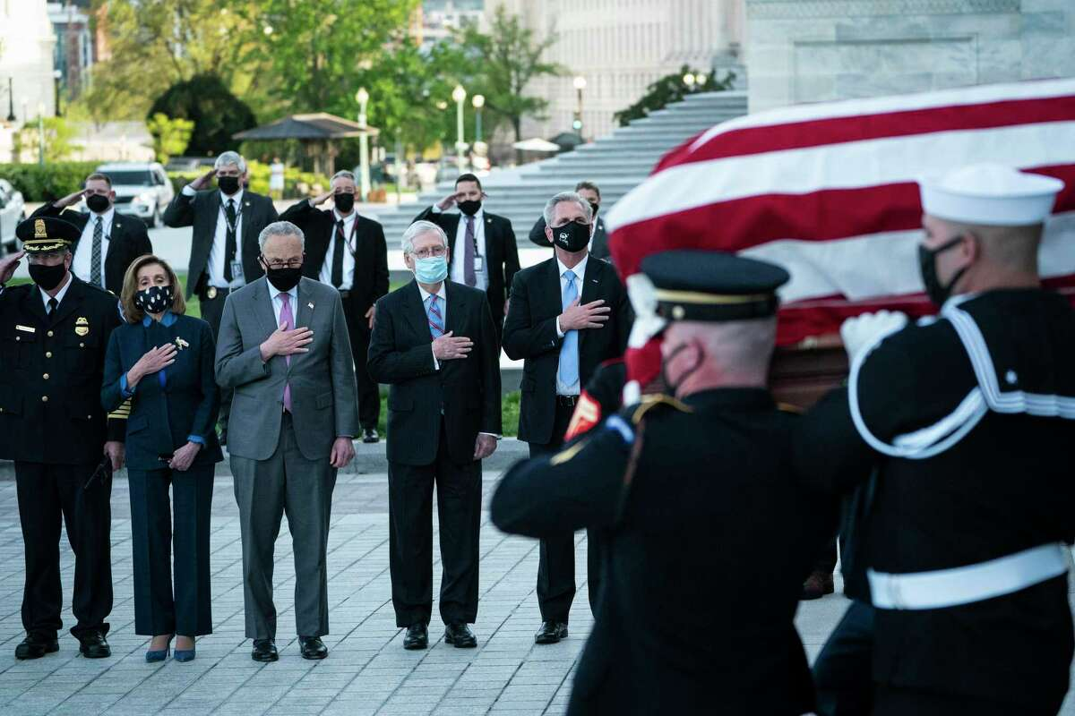 WASHINGTON, DC - APRIL 13: (L-R) U.S. House Speaker Nancy Pelosi (D-CA), Senate Majority Leader Chuck Schumer (D-NY), Senate Minority Leader Mitch McConnell (R-KY) and House Minority Leader Kevin McCarthy (R-CA) watch the casket of U.S. Capitol Police Officer William Evans being carried by a joint service honor guard down the East Front steps of the Capitol after lying in honor in the Rotunda on April 13, 2021 in Washington, DC. Evans was killed and another wounded after a man rammed through security and crashed into a barrier at the complex, forcing it into lockdown less than three months after the mob insurrection at Congress. (Photo by Jabin Botsford-Pool/Getty Images)