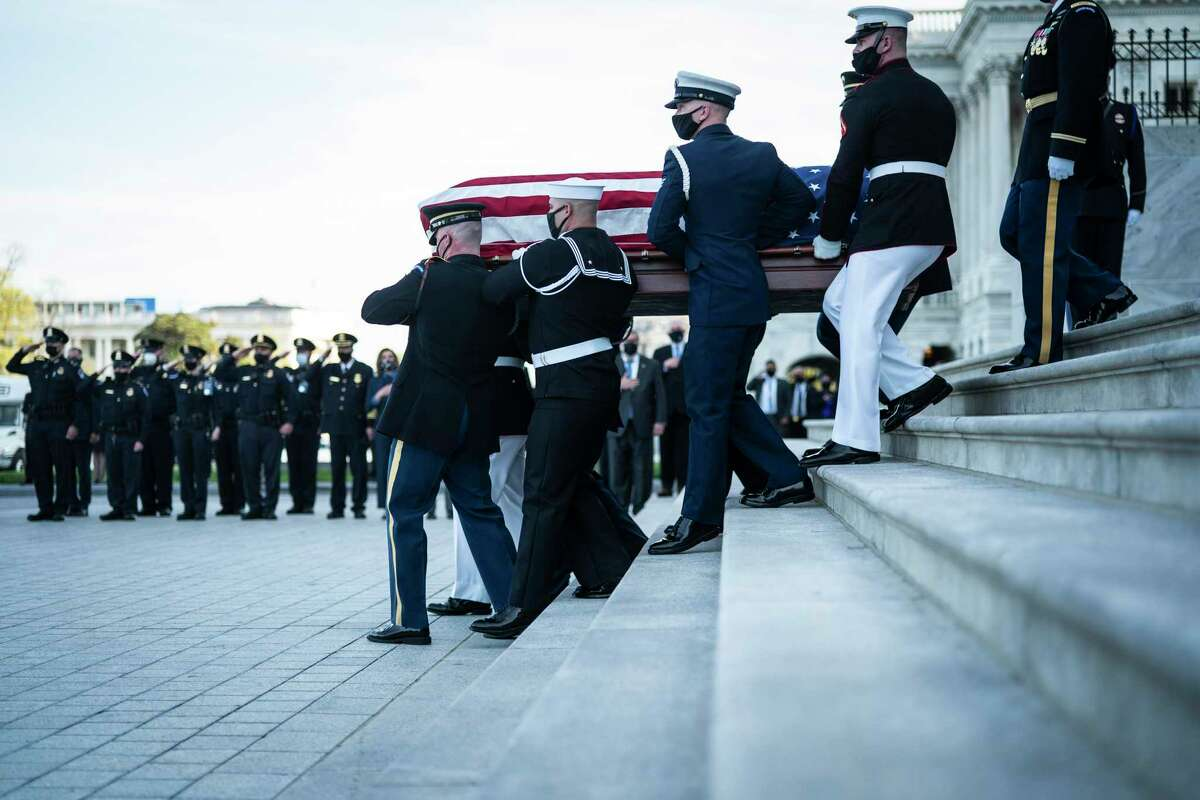 WASHINGTON, DC - APRIL 13: The coffin of U.S. Capitol Police Officer William Evans is carried by a Joint Service Honor Guard on the Capitol's Eastern Front after he closed in the Rotunda on April 13, 2021 in Washington, DC Honored.  Evans was killed and another injured after a man rammed through security and crashed into a barrier at the complex that forced him to lock down less than three months after the mob riot at Congress.  (Photo by Jabin Botsford-Pool / Getty Images)