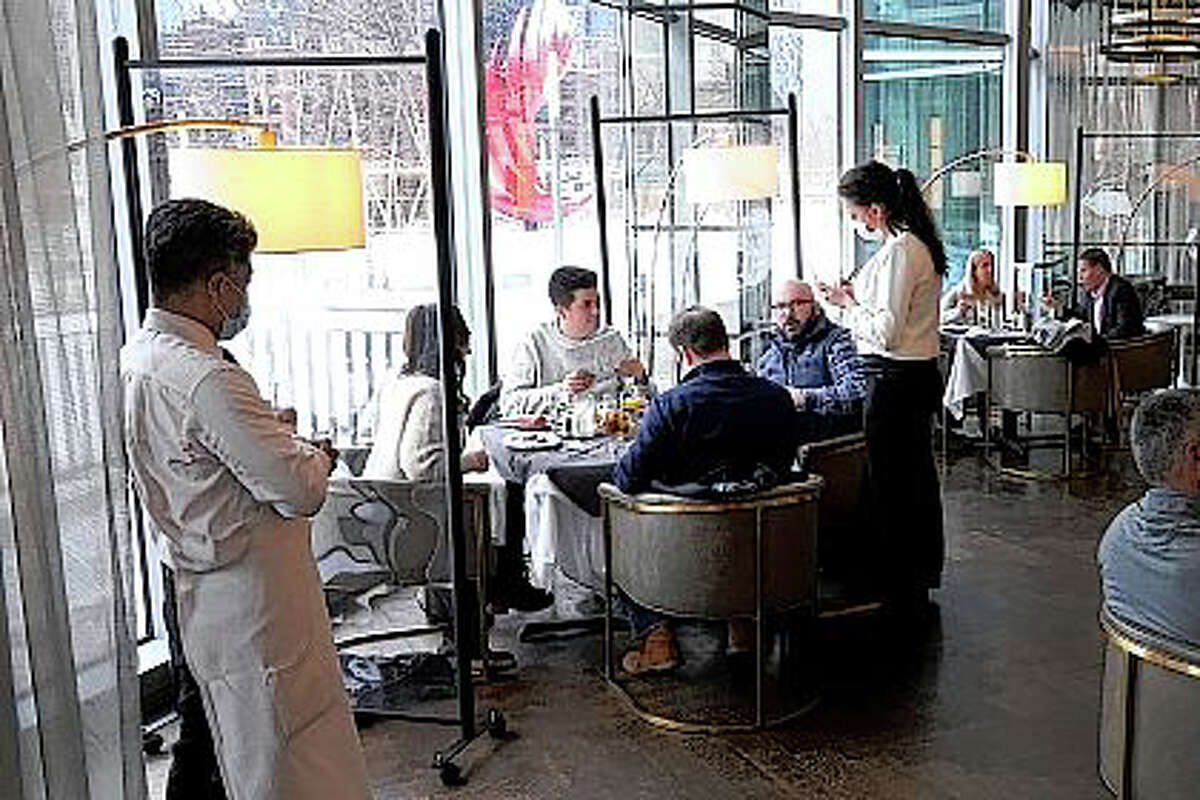 Patrons enjoy lunch indoors in January at Gibsons Italia restaurant in Chicago. A recent spike in coronavirus cases in some states has led one of the nation's top health experts to suggest that governors could