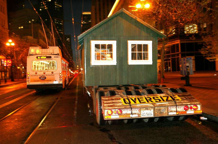 One of four restored earthquake refugee shacks from Kirkham Avenue in San Francisco is moved for display on Market Street in 2006. Photo: Mark Costantini / The Chronicle 2006