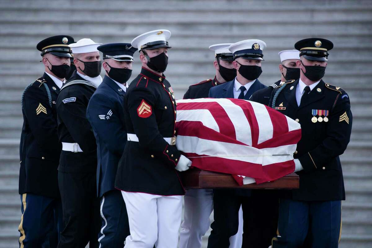 WASHINGTON, DC - APRIL 13: The casket of U.S. Capitol Police Officer William Evans is carried by a joint service honor guard at the East Front of the Capitol after lying in honor in the Rotunda on April 13, 2021 in Washington, DC. Evans was killed and another wounded after a man rammed through security and crashed into a barrier at the complex, forcing it into lockdown less than three months after the mob insurrection at Congress. (Photo by Michael Reynolds-Pool/Getty Images)