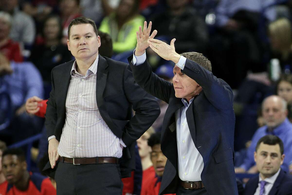 FILE - In this Thursday, Feb. 1, 2018 file photo, Gonzaga head coach Mark Few, right, calls a timeout as assistant coach Tommy Lloyd looks on during the second half of an NCAA college basketball game against San Diego in Spokane, Wash. Arizona has hired longtime Gonzaga assistant Tommy Lloyd as its next men's basketball coach, Wednesday, April 14, 2021. The school says Lloyd will receive a five-year contract, pending approval by the Arizona Board of Regents. (AP Photo/Young Kwak, File)
