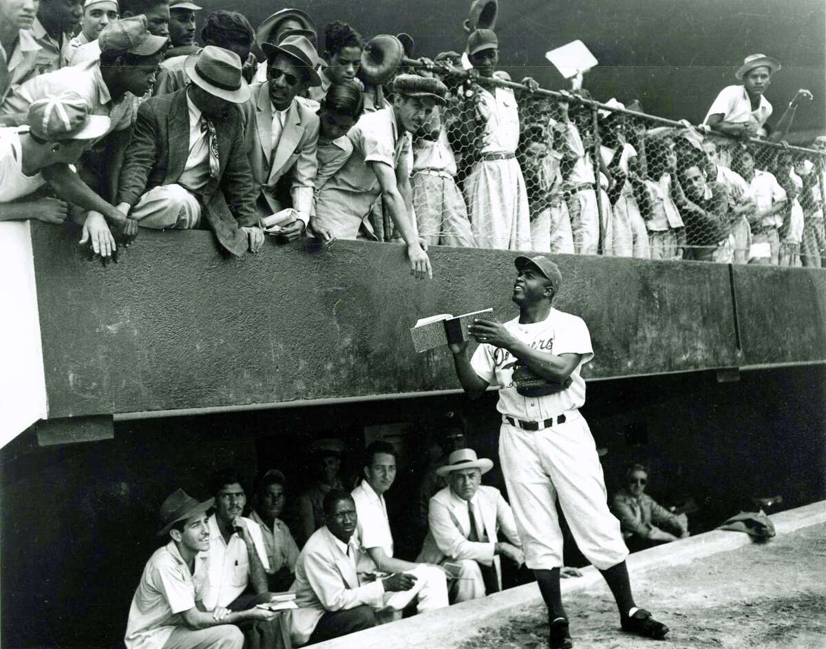 Jackie Robinson, foreground, and the Brooklyn Dodgers are at spring training in this photo taken in Ciudad Trujillo (present day Santo Domingo), Dominican Republic, in March 1948.