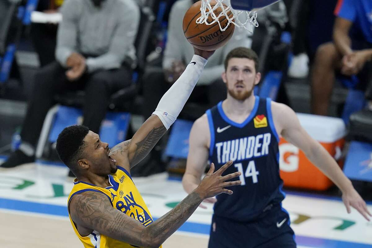 The Warriors' Kent Bazemore shoots in front of the Thunder's Svi Mykhailiuk in the second half of Golden State's 147-109 rout in Oklahoma City. Bazemore scored 15 points in 21 minutes.