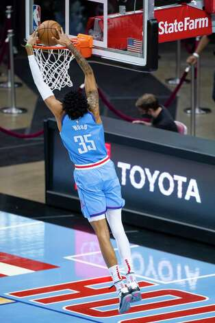 Houston Rockets center Christian Wood (35) dunks during the first quarter of an NBA game between the Houston Rockets and Indiana Pacers on Wednesday, April 14, 2021, at Toyota Center in Houston. Photo: Mark Mulligan, Staff Photographer / © 2021 Mark Mulligan / Houston Chronicle
