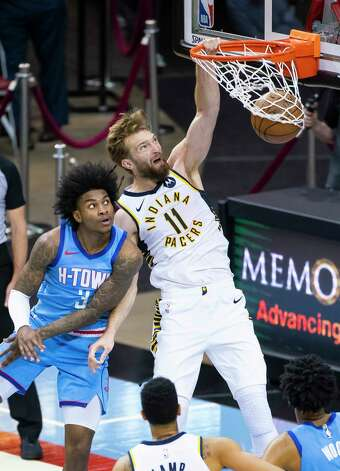 Indiana Pacers forward Domantas Sabonis (11) dunks over Houston Rockets guard Kevin Porter Jr. (3) during the fourth quarter of an NBA game between the Houston Rockets and Indiana Pacers on Wednesday, April 14, 2021, at Toyota Center in Houston. Photo: Mark Mulligan, Staff Photographer / © 2021 Mark Mulligan / Houston Chronicle