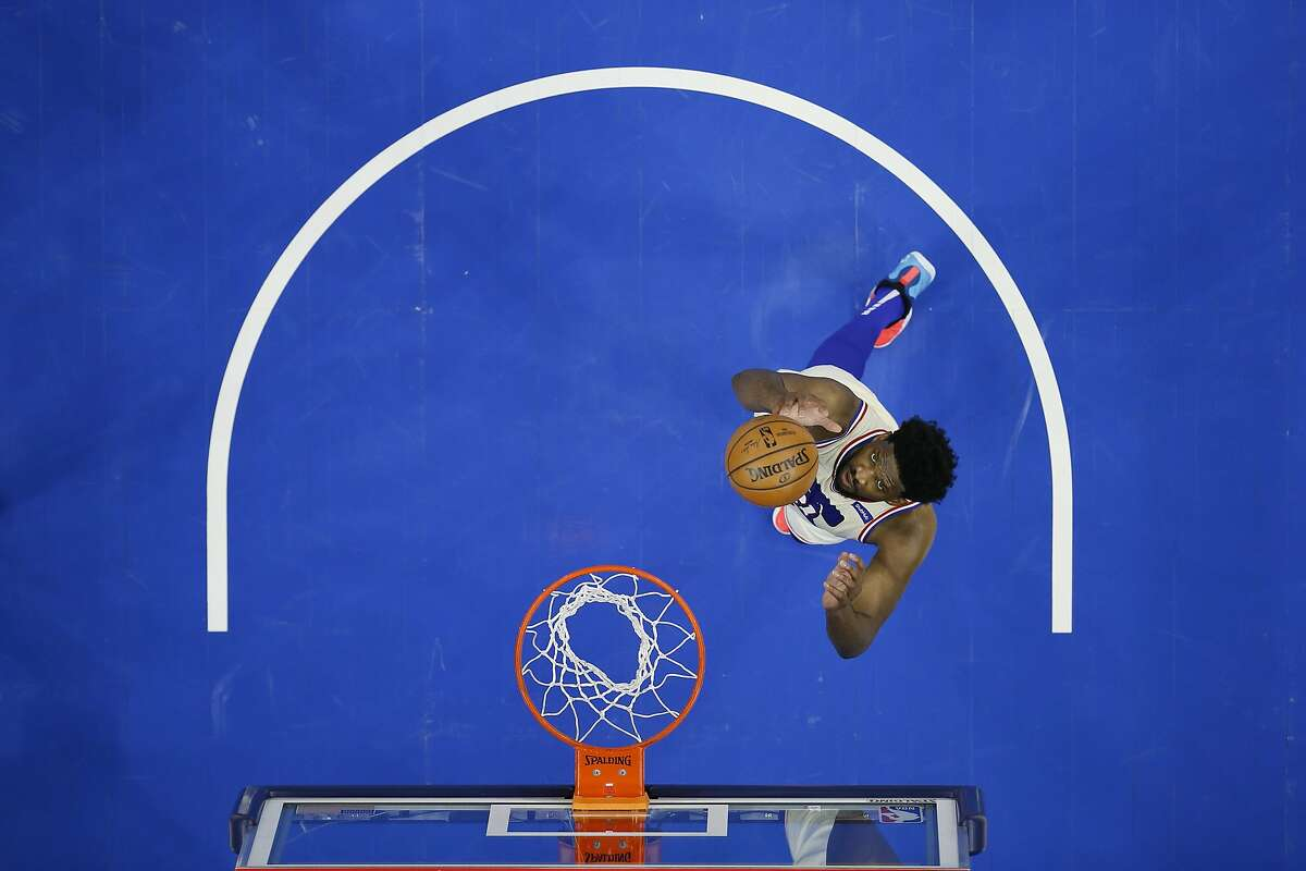 76ers center Joel Embiid plays during an NBA basketball game against the Brooklyn Nets, Wednesday, April 14, 2021, in Philadelphia. (AP Photo/Matt Slocum)