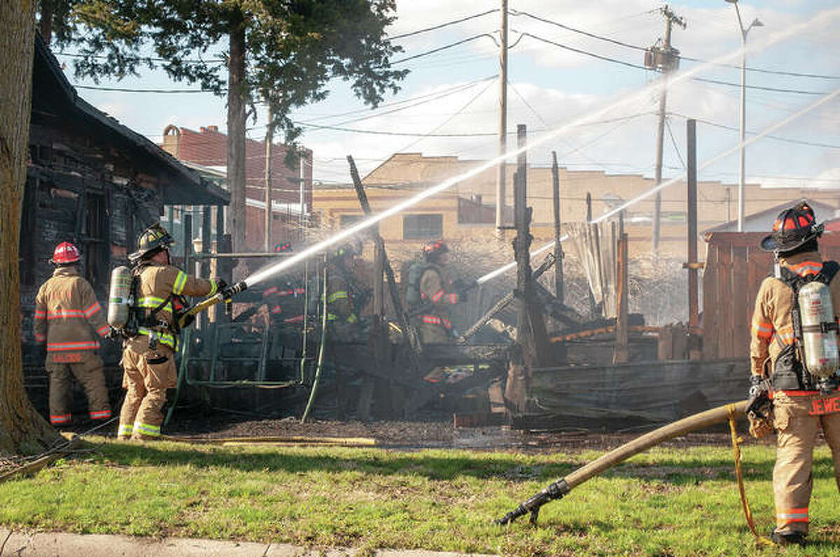 Fire destroyed a house at 216 E. College Ave. on Wednesday and spread to a wall of Muggsy's Fine Dining restaurant. Jacksonville, South Jacksonville and Woodson firefighters were on the scene for about two hours. Jacksonville Fire Chief Doug Sills said the cause of the fire was under investigation. No estimate of damage was available. Additional photos are online at myjournalcourier.com.