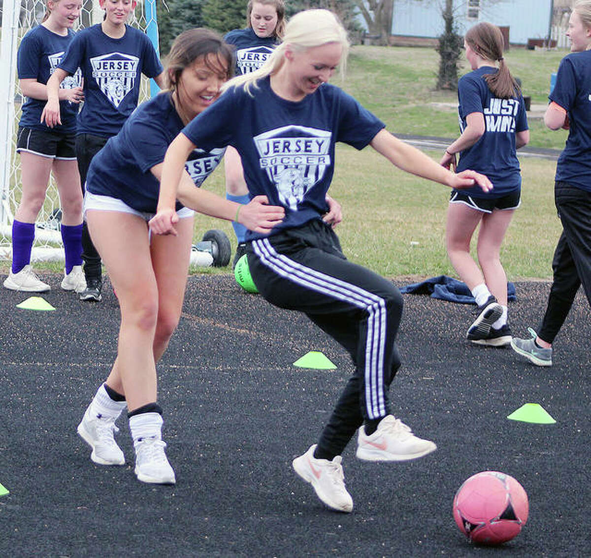 Brooklyn Winters, front, and Chloe Whited of Jersey work on a marking drill during a 2020 practice. In Wednesday's 2021 season opener, Winters scored twice and Whited once in a 6-2 home win over Southwestern.