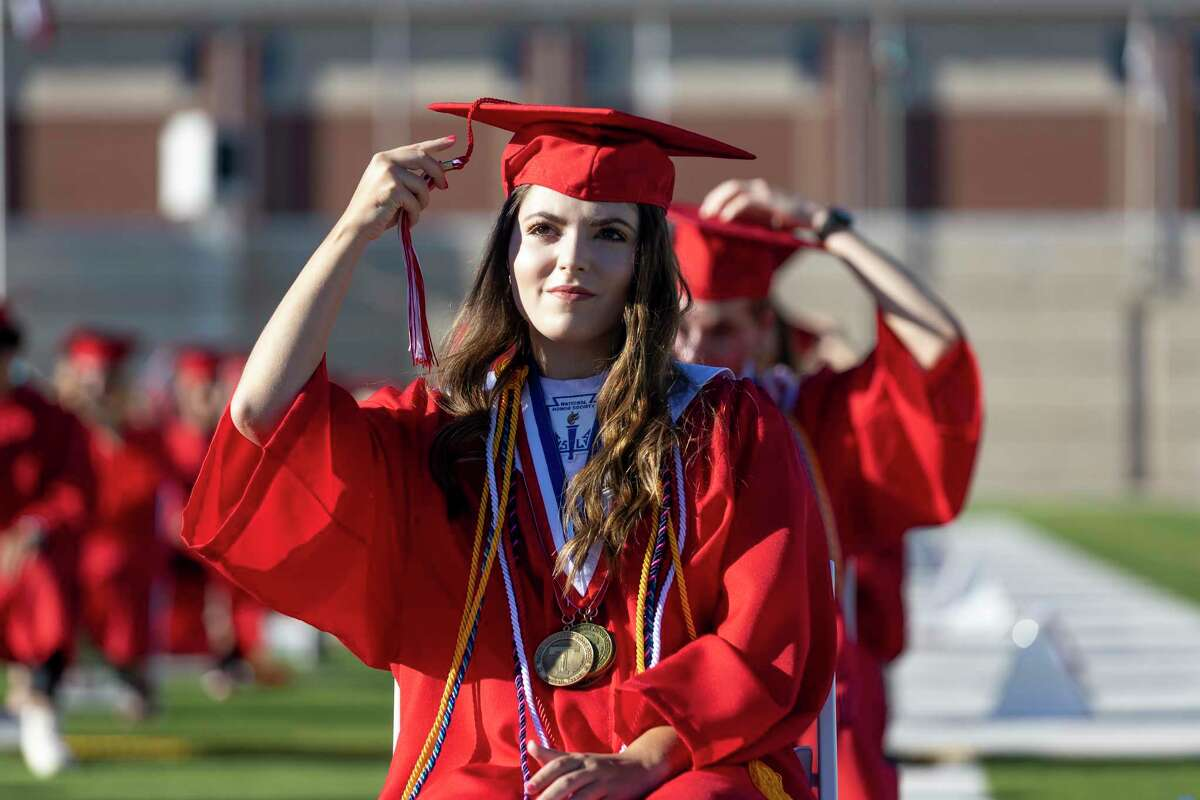 A graduate of Tomball High School moves her tassel to symbolize her graduating at Woodforest Bank Stadium in Shenandoah, Thursday, June 11, 2020. Graduates were placed 6 feet apart to practice social distancing during the ceremony.