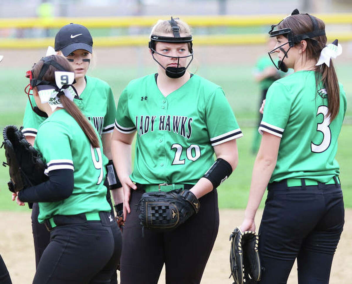 Carrollton's Hannah Rhoades, shown huddling with teammates during a visit in a 2019 game, was back in the circle at Wright Park in Carrollton on Wednesday to pitch the Hawks to a season-opening win over Auburn.