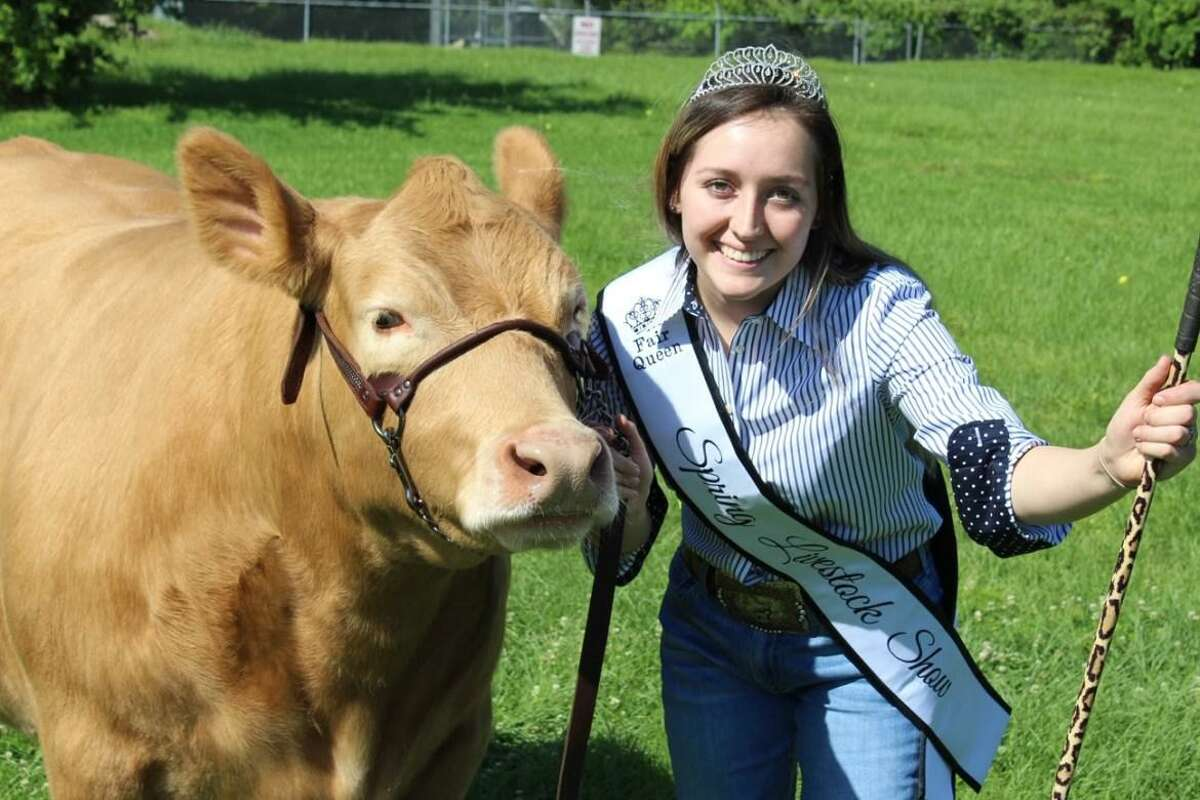 Jasmine Moynahan, Spring High School alumna and former FFA Chapter president, poses with her steer, the animal that sold for the highest price during last year's online auction.