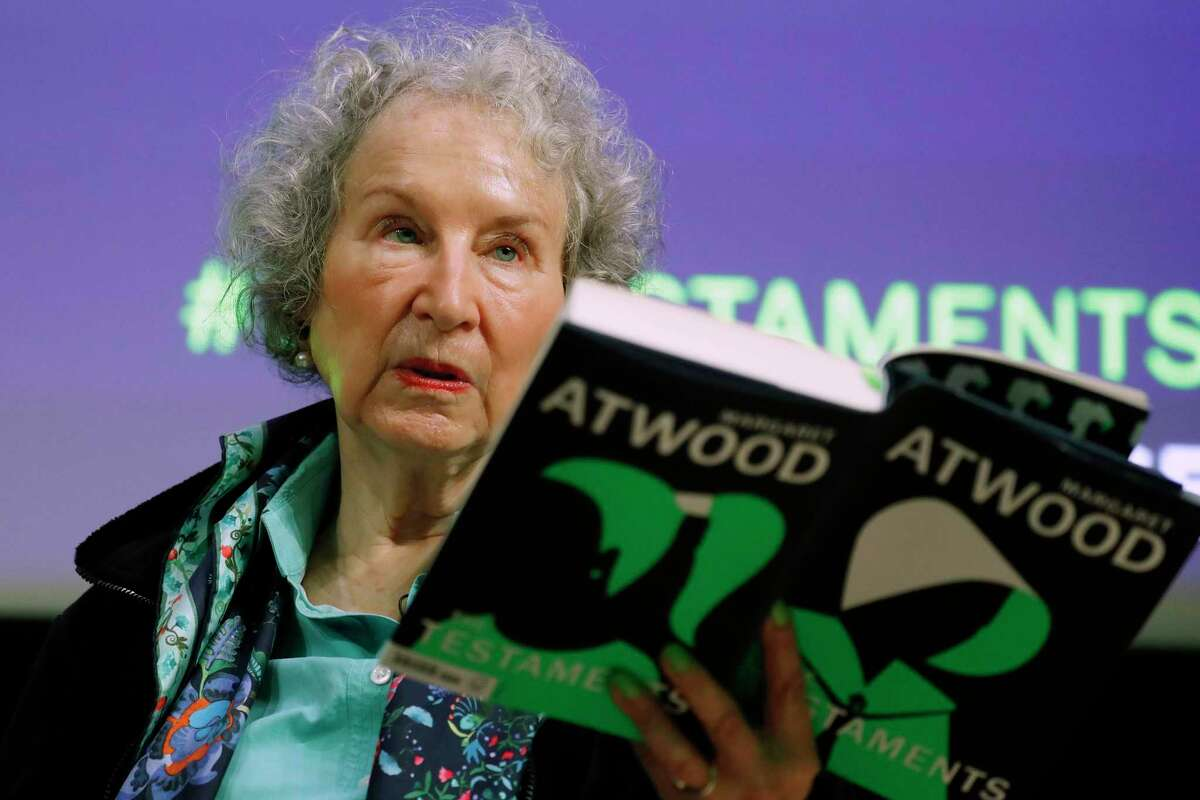 Canadian author Margaret Atwood holds a copy of her book