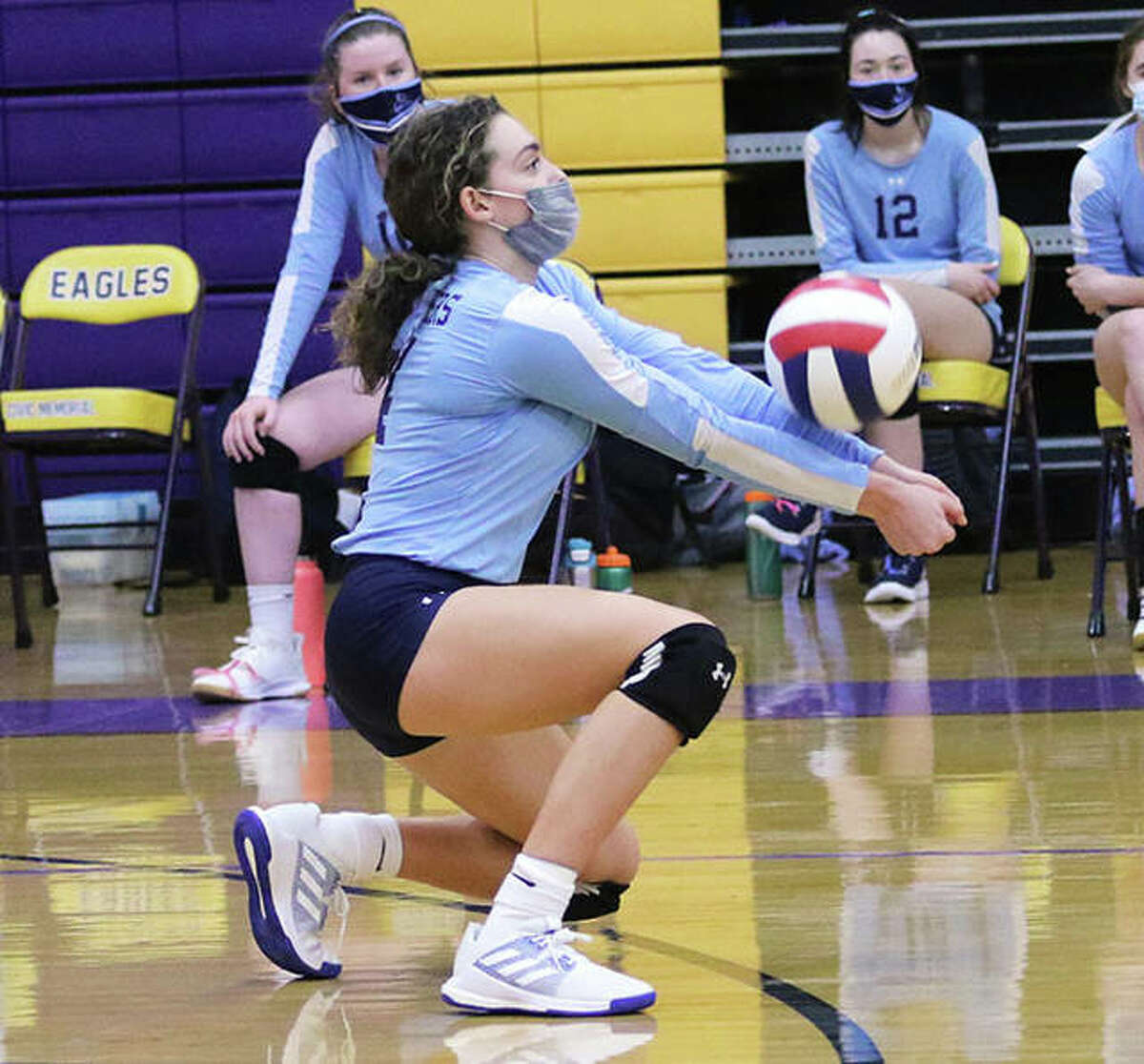 Jersey's Chloe White, shown receiving a serve in a March 18 match vs. CM in Bethalto, had five kills in the Panthers' victory over Calhoun on Wednesday night in Jerseyville.