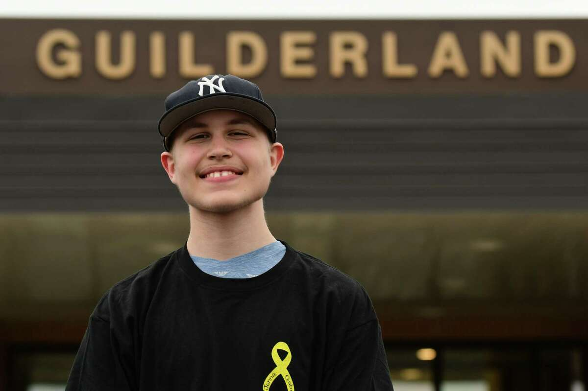 Gabe Zullo, 14, stands in front of Guilderland High School on Monday, April 12, 2021 in Guilderland, N.Y.(Lori Van Buren/Times Union)