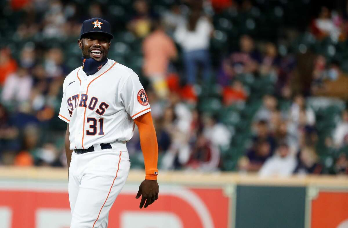 Houston Astros designated hitter Ronnie Dawson (31) can't hide his joy as he prepares for his Major League Baseball debut on Wednesday at Minute Maid Park.