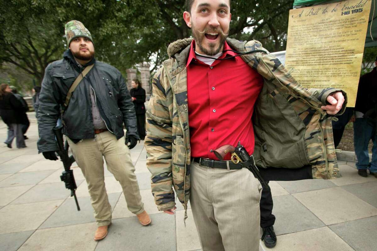 Ben Franklin, right, of Arlington, Texas, carries an 1858 black powder pistol at a rally to support HB 195, which would allow the open carry of handguns with no permitting or background check requirements, at the Capitol, Tuesday, January 13, 2015, in Austin, Texas. (AP Photo/Austin American-Statesman, Jay Janner) AUSTIN CHRONICLE OUT, COMMUNITY IMPACT OUT, INTERNET AND TV MUST CREDIT PHOTOGRAPHER AND STATESMAN.COM, MAGS OUT