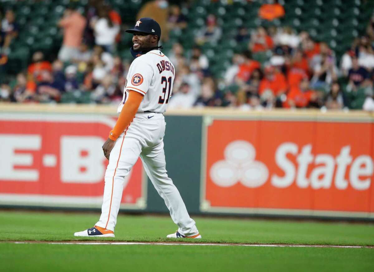 Houston Astros designated hitter Ronnie Dawson (31) warms up before the first inning of an MLB baseball game at Minute Maid Park, in Houston, Wednesday, April 14, 2021.