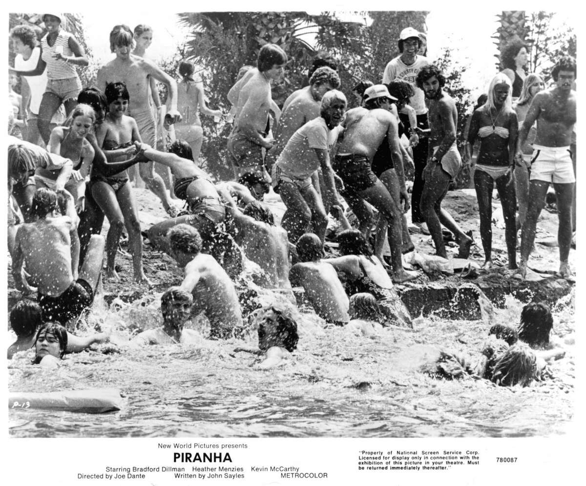 Swimmers rush from the lake in a scene from the film