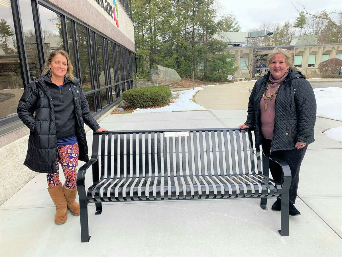 """The """"Loved"""" team of Jessica Stewart and Cath Pezze with the bench donated to the CHH Center for Cancer Care by supporters of """"Loved."""""""