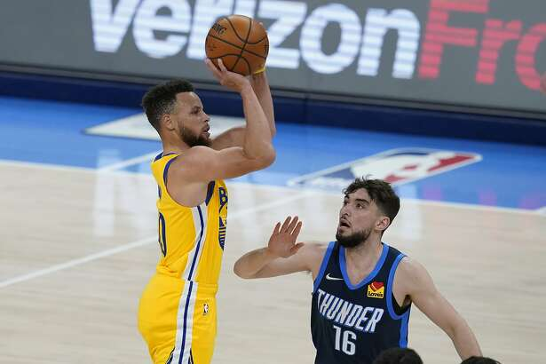 Golden State Warriors guard Stephen Curry, left, shoots over Oklahoma City Thunder guard Ty Jerome (16) in the second half of an NBA basketball game Wednesday, April 14, 2021, in Oklahoma City. (AP Photo/Sue Ogrocki)