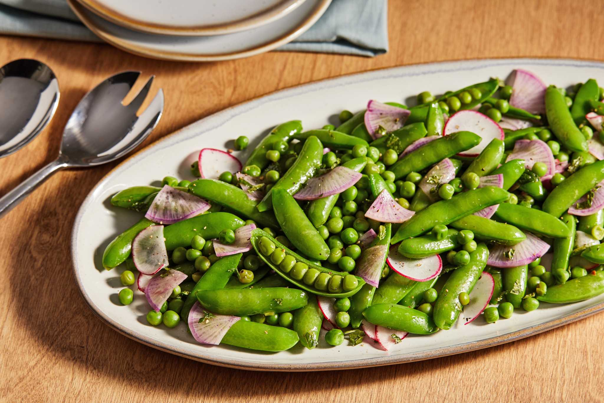 Loaded with two types of peas, radishes and mint, this lemony salad sings spring