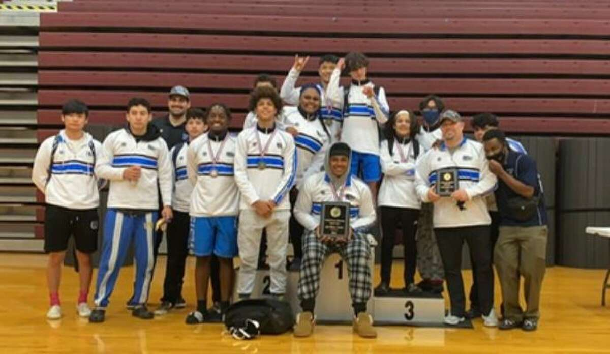 The Westside boys wrestling team won its 20th consecutive district championship, qualifying nine wrestlers for the regional tournament.